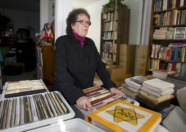 Helen Radkey is a researcher who publicizes the LDS Church's baptism-for-the-dead of Holocaust victims and Catholic Saints.  Here she goes through some of her numerous boxes of research files on the baptisms that take up part of an extra bedroom in her home.