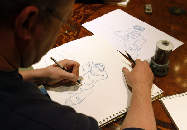 Salt Lake City -  Prince and the Frog animator Randy Haycock draws the character of Prince Naveen, as a frog, during interview at the Grand America in Salt Lake City Monday Dec 7, 2009.  Haycock is the supervising animator for Prince Naveen.