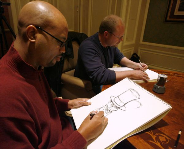 Salt Lake City -  Prince and the Frog animators Bruce Smith and Randy Haycock draw their characters during interview at the Grand America in Salt Lake City Monday Dec 7, 2009. Smith is the  supervising animator for Dr. Facilier and Haycock is the supervising animator for Prince Naveen.