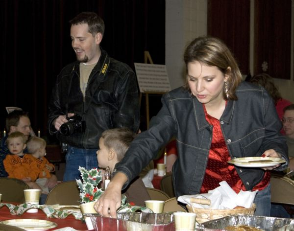This image provided by Suzy Guzman shows Susan Powell, right, at a church function with her husband Josh Powell, left, Dec. 5, 2009 in West Valley City, Utah. Susan Powell, 28, was reported missing on Dec. 7, 2009. (AP Photo/Suzy Guzman) **NO SALES **