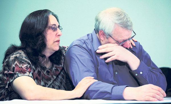 Chuck Cox, right, the father of Susan Powell, who was reported missing Dec. 7 in Utah, is comforted Thursday by his wife, Judy, as he and other family members talk to reporters in Puyallup, Wash. Family members say they are saddened Powell's husband, Joshua, is a person of interest in the investigation.