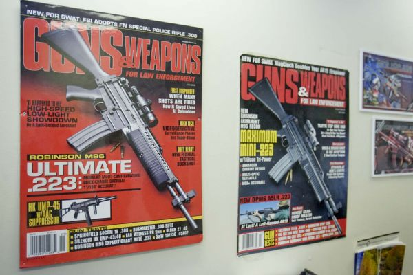 Poster-size magazine covers featuring Robinson Armament's guns adorn the office space of the Salt Lake City company. The firearms maker, which employs about 15 people, is one of several Utah companies that would be marginally affected by a proposal to exempt guns made, sold and kept in Utah from federal firearms regulations.