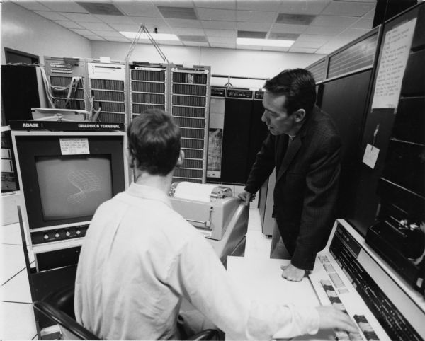 Photo Special Collections/Marriott Library/University of Utah     David C. Evans, who founded the University of Utah computer science department in 1966, is shown in the computer center around 1970. Evans brought millions of federal dollars to Utah for computer research and his efforts were responsible for the university being one of the four original