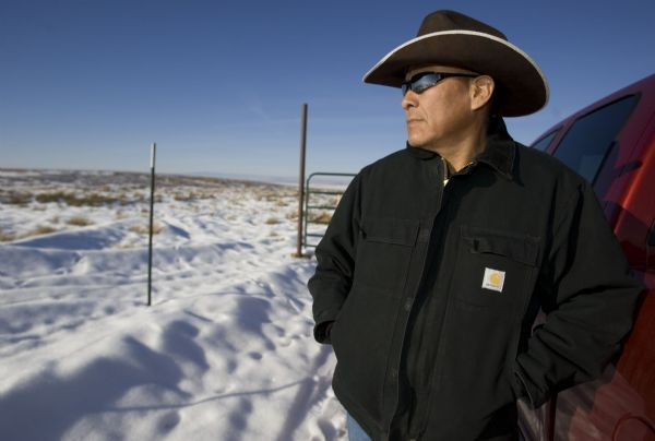 With the vistas of the Navajo Indian reservation reflected in his glasses, rancher and former San Juan County commissioner Mark Maryboy talks about how money from the Utah Navajo Trust may be invested into the community.