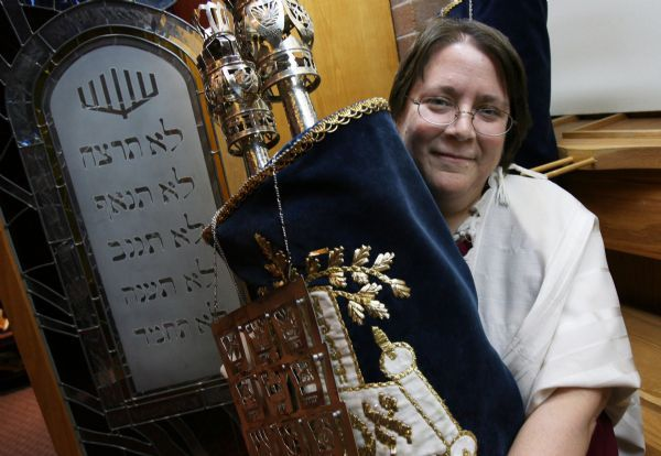 Salt Lake City - Rabbi Tracee Rosen of Congregation Kol Ami in Salt Lake City, pictured with one of their scrolls will be leaving soon.  Photo by Francisco Kjolseth/The Salt Lake Tribune 9/08/2009