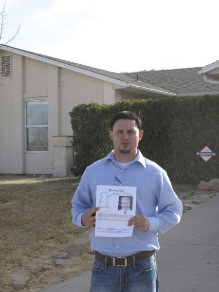 Greg Webb, standing outside the St. George house where Steven Koecher lived when he was last seen Dec. 13, holds a flier being circulated with hopes someone will step forward with information about where his friend might be. Webb said Koecher had been actively looking for a full-time job and had sent out his resume to a list of possible employers.