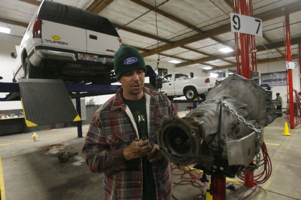 Garage opens doors for self service auto repairs the salt lake tribune phillip orton of murray works on a car tranmission in mid december solutioingenieria Image collections
