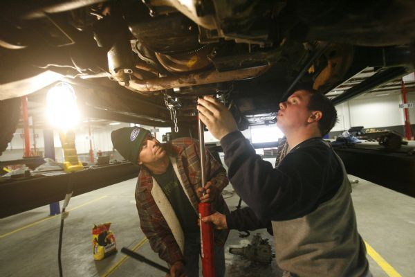 Garage opens doors for self service auto repairs the salt lake tribune phillip orton left and brandon lewis of murray work on the tranmission solutioingenieria Image collections