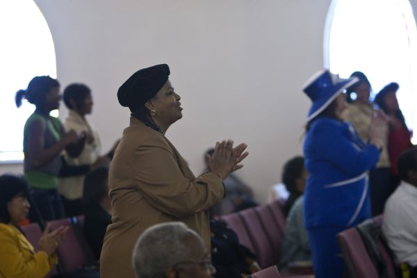 Berna Ford, center, claps her hands during the Sunday morning worship service at the Second Baptist Church in Ogden Sunday January 10, 2010.