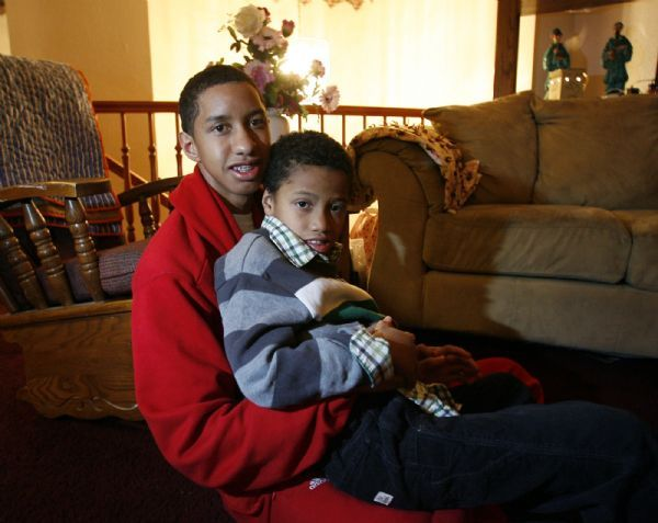 Orem -   American Fork basketball player Marcel Davis, snuggles with his brother Matteo, who is severely autistic in their Orem home  Tuesday Jan 12, 2010.  A horrible incident brought the two brothers even closer together and has given Marcel a different outlook and perspective.