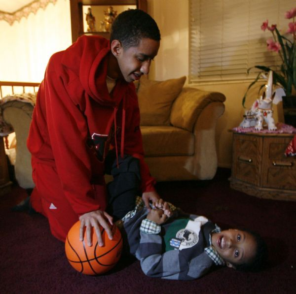 Orem -   American Fork basketball player Marcel Davis, plays with his brother Matteo, who is severely autistic in their Orem home  Tuesday Jan 12, 2010.  A horrible incident brought the two brothers even closer together and has given Marcel a different outlook and perspective.