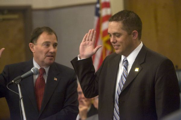 Gov. Gary Herbert left, administers the oath of office to new Mayor Steve Hiatt at the Kaysville City Hall on Jan. 4.