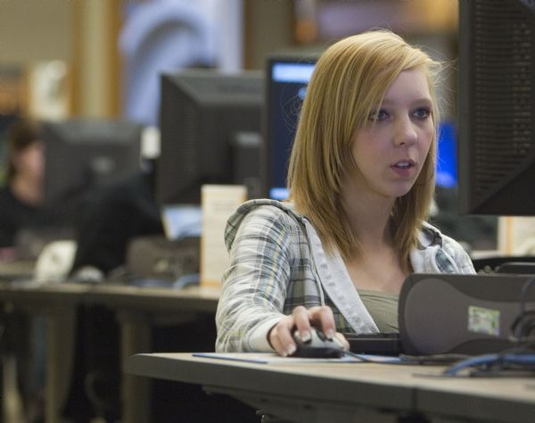 Ashlie Wessendorf of Murray does research in the computer lab in student center Wednesday, January 20, 2010 at Salt Lake Community College Redwood Road campus in Taylorsville. Lawmakers are discussing what to cut out of higher education spending and making a list. SLCC, with a massive enrollment surge in the works, will likely being feeling the pain more than any other institution.