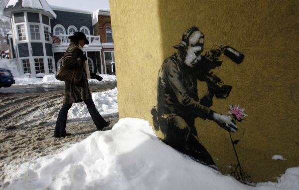 Park City - A graffitti piece by artist Bansky lines one of the walls along Main Street in Park City as the Sundance Film Festival gets underway on Thursday, Jan. 21, 2010. It is rumored that the famous artist may be revealed during the festival.