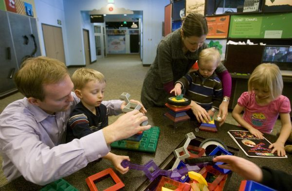 Becker aide Ben McAdams spends some time with his wife Julie and thier kids, James, Robert and Kate, at the Discovery Gateway, Wednesday, January 13, 2010