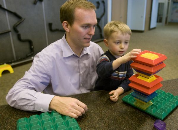 Becker aide Ben McAdams spends some time with his son James,  at the Discovery Gateway, Wednesday, January 13, 2010
