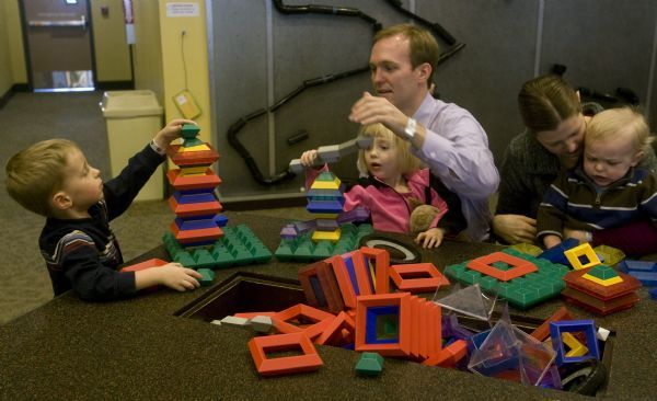 Becker aide Ben McAdams spends some time with his wife Julie and thier kids,  James, Kate and Robert, at the Discovery Gateway, Wednesday, January 13, 2010