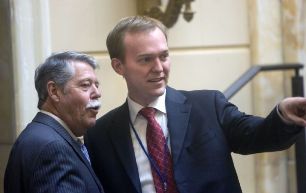 Veteran senator Gene Davis, left,  D, Distirct 3, Salt Lake County, talks to  new Democratic state senator Ben McAdams, before he took his oath of office in a brief ceremony in the Senate Chamber on Tuesday.    McAdams, the senior adviser to Mayor Ralph Becker, was selected to replace Sen. Scott McCoy who is leaving his post to spend more time with his law firm.