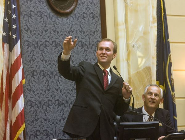 New Democratic state senator Ben McAdams, left, shows President of the senate Michael Waddoups members of his family in the overhead senate gallery after being sworn in by Waddoups.    McAdams, the senior adviser to Mayor Ralph Becker, was selected to replace Sen. Scott McCoy who is leaving his post to spend more time with his law firm.