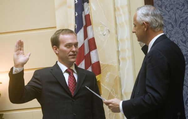 New Democratic state Sen. Ben McAdams, left, takes the oath of office in a brief ceremony Tuesday in the Senate Chamber. Senate President Michael Wadoups administers the oath. McAdams, the senior adviser to Mayor Ralph Becker, was selected to replace Sen. Scott McCoy who is leaving his post to spend more time with his law firm.