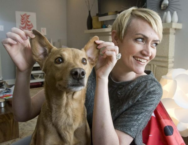 Heather Armstrong plays with her dog Chuck on Friday.