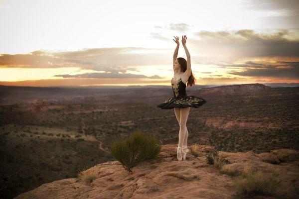 Cristiana Bennett, Ballet West dancer photographed on Diving Board Rock, Moab UT. Black Swan. Courtesy photography, shot by Erik Ostling (umlat over the O).