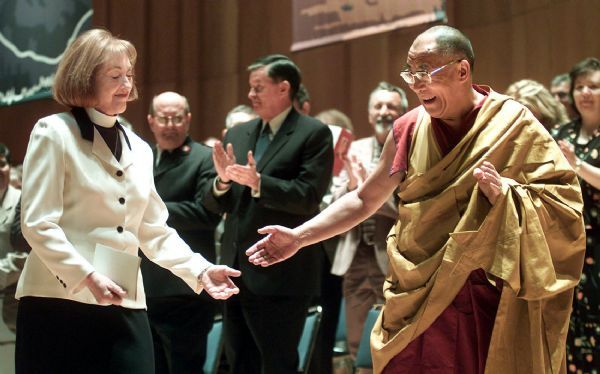 His Holiness the Fourteenth Dalai Lama joins the Right Rev. Carolyn Tanner Irish, Episcopal bishop of Utah, at an Interfaith Service at Abravanel Hall in Salt Lake City in May 2001.