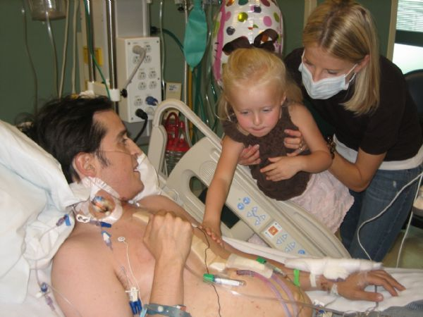 Paul Cardall greets his daughter Eden and his wife Lynnette after his heart transplant.