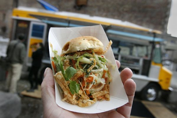 A spicy beef slider topped with crisp Asian slaw and wonton crunchies from The Chow Truck. It's a bright yellow food truck that serves gourmet tacos and sliders. The owners are SuAn Chow, the original owner of Charlie Chow's and chef Rosanne Ruiz of Capital Cafe, Sage's Cafe and Vinto.