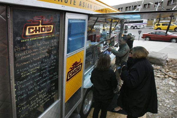 Customers line up to order from the the Chow Truck menu. The menu features tacos, sliders, soup, salads, sides and daily specials with an Asian twist.