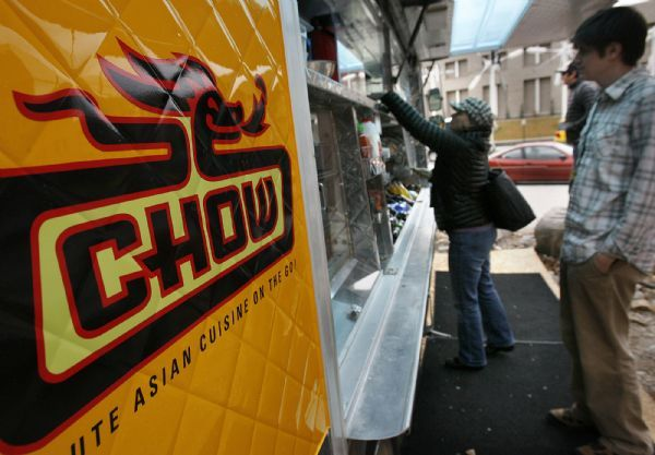 The Chow Truck is a bright yellow food truck that serves gourmet tacos and sliders.