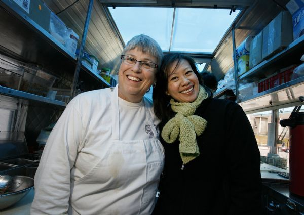 The owners of the Chow Truck, a bright yellow food truck that serves gourmet tacos and sliders, are chef Rosanne Ruiz, left; formerly of Capital Cafe, Sage's Cafe and Vinto, and right; SuAn Chow, the original owner of Charlie Chow's.