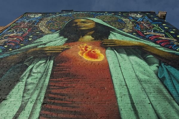 A 44x22 foot mural of the Virgin Mary on the east side of the building at 158 E 200 South Saturday, February 20, 2010. Two artists, El Mac and Retna, created the mural.