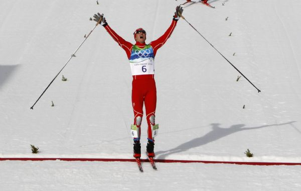 United States' Bill Demong crosses the finish line to winning the gold medal during the Men's Nordic Combined Individual event from the large hill at the Vancouver 2010 Olympics in Whistler, British Columbia, Canada, Thursday, Feb. 25, 2010. (AP Photo/Matthias Schrader)