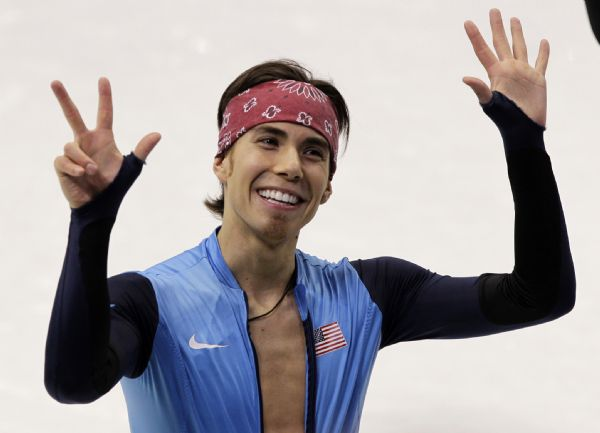 USA's Apolo Anton Ohno holds up eight fingers, representing the number of medals he has won, after the U.S. won the bronze medal for the men's 5000m relay short track skating competition at the Vancouver 2010 Olympics in Vancouver, British Columbia, Friday, Feb. 26, 2010. (AP Photo/Mark Baker)