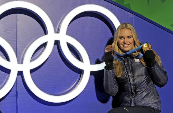 Bronze medalist Lindsey Vonn of the United States poses for photographers during the medal ceremony for the Women's super-G at the Vancouver 2010 Olympics in Whistler, British Columbia, Saturday, Feb. 20, 2010. Vonn is also holding the gold medal she won in the Women's downhill.  (AP Photo/Gero Breloer)