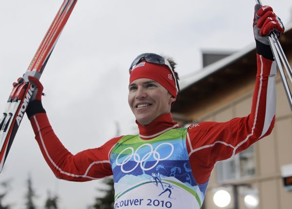 United States' Bill Demong celebrates winning the gold medal during the Men's Nordic Combined Individual event from the large hill at the Vancouver 2010 Olympics in Whistler, British Columbia, Canada, Thursday, Feb. 25, 2010. (AP Photo/Elaine Thompson)