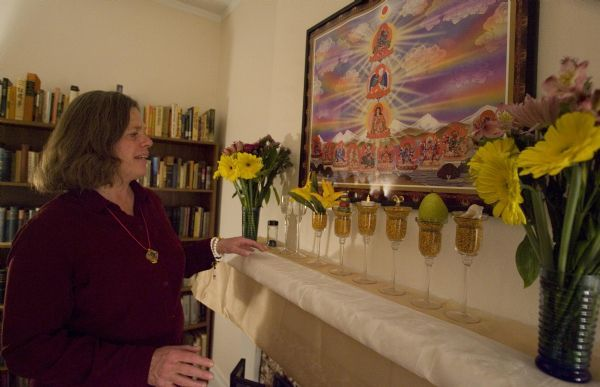 Margaret Esterman director of the Xuanfa Dharma Center of Utah explains the meaning of an alter to Dorje Chang Buddha III Wednesday, February 24 2010 in her home in Salt Lake City. Esterman is a follower of His Holiness Dorje Chang Buddha III, who is believed to be the first reincarnation of the Buddha in 2,500 years. She has opened the Xuanfa Dharma Center of Utah in her home, to offer free, weekly dharma listening sessions of his teachings. 2/24/10