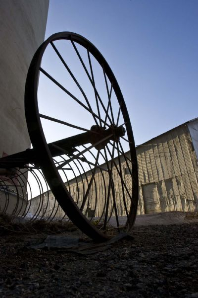 Paul Fraughton   |  Tribune file photo A rusted harrow sits next to the towers of the old sugar factory in West Jordan. An arts group hopes to make an arts complex of the old buildings at the Sugar Factory. Right now, the West Jordan Arts Council operates a theater there.