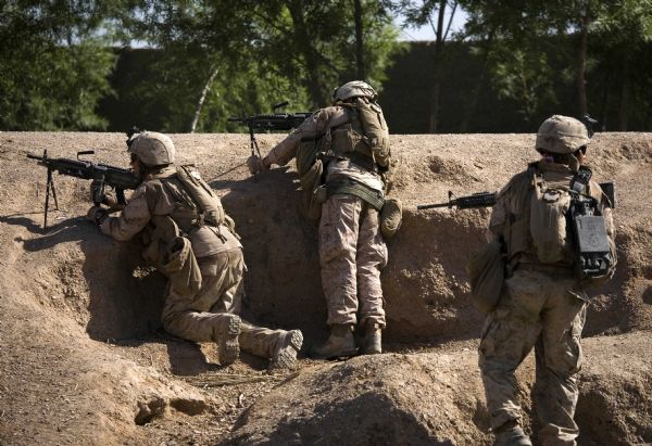 U.S. Marines of the First Battalion, Sixth Marine Regiment, Alpha company, take offensive position as they are involved in a gunbattle during a patrol in Marjah, Afghanistan, Friday, March 19, 2010. (AP Photo/Dusan Vranic)