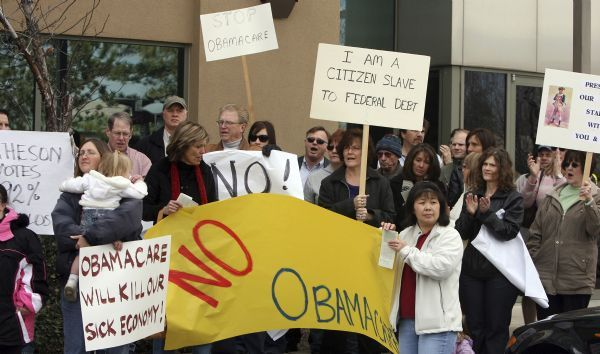 Tea Party supporters and other Utahns rallied on Friday outside of Rep. Jim Matheson's office urging him to vote