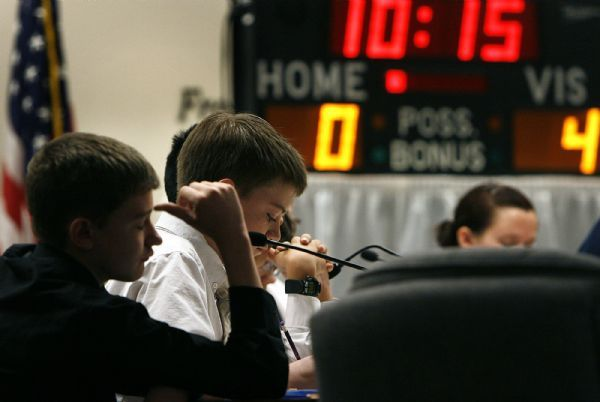 ACADEMIC GAMES  Brockbank's Anthony DiDunato (left) thinks about a question during the first quarter. Tyler Adams is at center. Wasatch defeated Brockbank 100-80 Thursday, 3/18/2010. Magna's Brockbank Junior High battled Salt Lake City's Wasatch Junior High for the Academic Games district title.
