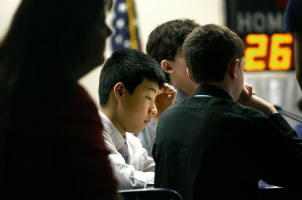ACADEMIC GAMES  Brockbank's Jinhua Shen (cq) thinks about an answer while his coach Lisa Shafer watches at left. Wasatch defeated Brockbank 100-80 Thursday, 3/18/2010. Magna's Brockbank Junior High battled Salt Lake City's Wasatch Junior High for the Academic Games district title.