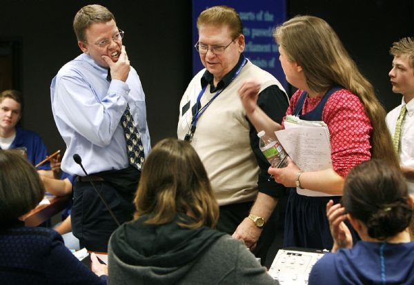 ACADEMIC GAMES  Wastach Jr's head coach Tom Allen (left) and Brockbank's Lisa Shafer (right) confer with the judges over a rules interpretation during a break between quarters. Wasatch defeated Brockbank 100-80 Thursday, 3/18/2010. Magna's Brockbank Junior High battled Salt Lake City's Wasatch Junior High for the Academic Games district title.