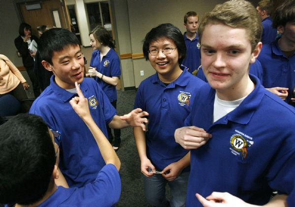 ACADEMIC GAMES  The winning Wasatch Jr. team relives it's win just after the final score was made official. Rajdeep Trilokekar (lower left) points his finger as he makes a point with team mates (left to right); Daniel Liu, Vincent Fu, and Abraham Moffatt. Wasatch defeated Brockbank 100-80 Thursday, 3/18/2010. Magna's Brockbank Junior High will battle Salt Lake City's Wasatch Junior High for the Academic Games district title.
