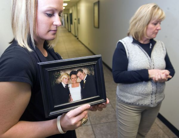 Al Hartmann  |  The Salt Lake Tribune   3/22/2010 Researchers and public health workers gathered Monday at the Utah Health Dept. to discuss the results of a study on who dies from prescription drugs in Utah.   Larah Kofoed, left, holds a photo of the three siblings in her family.  Pictured from left, Dominic Barnes, Larah Kofoed and Derek Barnes.  Derek died from a prescription drug overdose in June 2009.  Gayle Barnes, mother of the family at right.   The two atended the release of the study.
