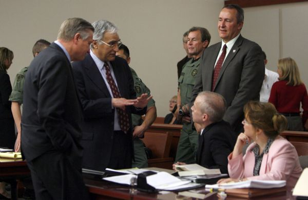 Francisco Kjolseth  |  The Salt Lake Tribune  Defense attorney Andrew Parnes, second from left, speaks with prosecutors Thomas Brunker, sitting, and Erin Riley, after a judge set a June 18 execution date for Ronnie Lee Gardner at the Matheson Courthouse in Salt Lake City on Friday. Standing, from left, are Salt Lake County Prosecutor Bob Stott and Utah Attorney General Mark Shurtleff.