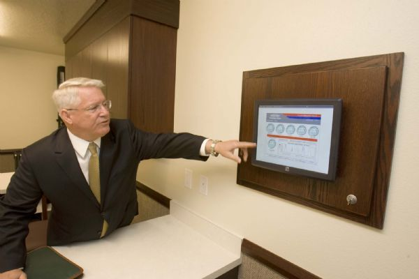 Dean Davies, the managing director  of physical facilities for the LDS Church points out a  panel  inside a new LDS stake house  in Farmington that shows  the energy consumption of the building.  New construction techniques, systems  and materials used in the building  make it a LEED certified building. on  Tuesday, April 27,2010  photo:Paul Fraughton/ The Salt Lake Tribune