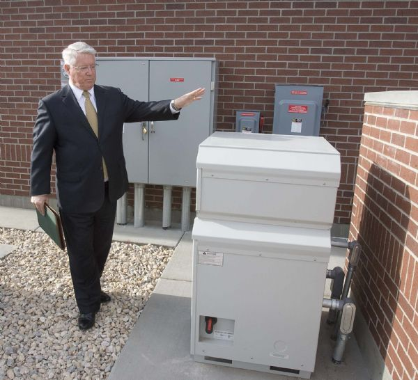 Paul Fraughton     The Salt Lake TribuneDean Davies, the managing director  of physical facilities for the LDS Church, shows off a power converter at the side of a newly constructed stake house in Farmington. The converter takes the  direct current from the roof mounted solar panels and converts it into alternating current for use in the  building.