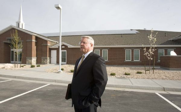 Paul Fraughton  |  The Salt Lake Tribune  Dean Davies, the managing director  of physical facilities for the LDS Church, stands outside a newly constructed stake house in Farmington. Solar panels on the roof provide electrical energy to the building.